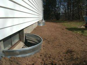 grade water away from foundation prevent mold removal Indianapolis