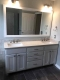 Bathroom Remodel - a new modern vanity, framed mirrors, new lighting and hardware replaces the old builder grade oak model
